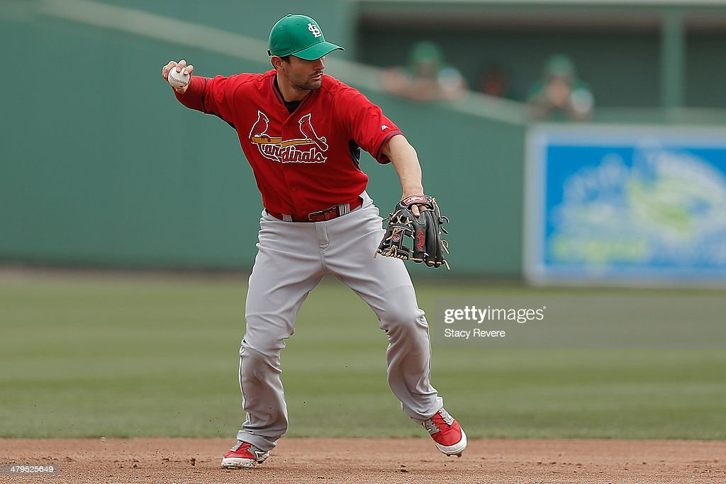 Pete Kozma #38 of the St. Louis Cardinals fields a ball in the first inning of a game against the Boston Red Sox at JetBlue Park at Fenway South on March 17, 2014 in Fort Myers, Florida. Boston won the game 10-5.