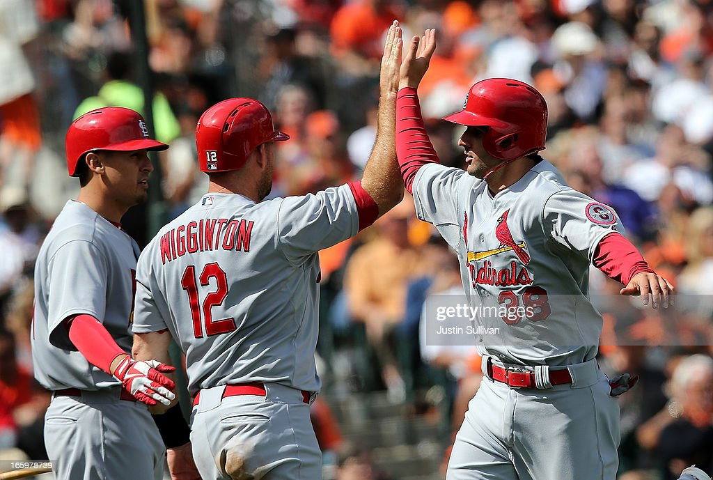 Pete Kozma #38 of the St. Louis Cardinals is congratulated by teammate Ty Wigginton #12 after scoring a run during the fourth inning against the San Francisco Giants at AT&T Park on April 7, 2013 in San Francisco, California.