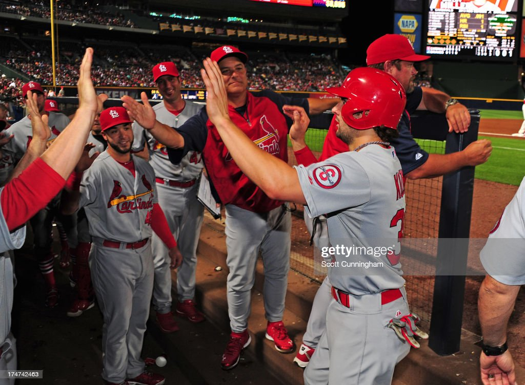 <a gi-track='captionPersonalityLinkClicked' href=/galleries/search?phrase=Pete+Kozma&family=editorial&specificpeople=6800748 ng-click='$event.stopPropagation()'>Pete Kozma</a> #38 of the St. Louis Cardinals is congratulated by teammates after scoring a fifth inning run against the Atlanta Braves at Turner Field on July 28, 2013 in Atlanta, Georgia.