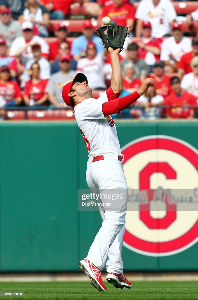 Pete Kozma #38 of the St. Louis Cardinals makes the catch against the Cincinnati Reds during Opening Day on April 8, 2013 at Busch Stadium in St. Louis, Missouri.
