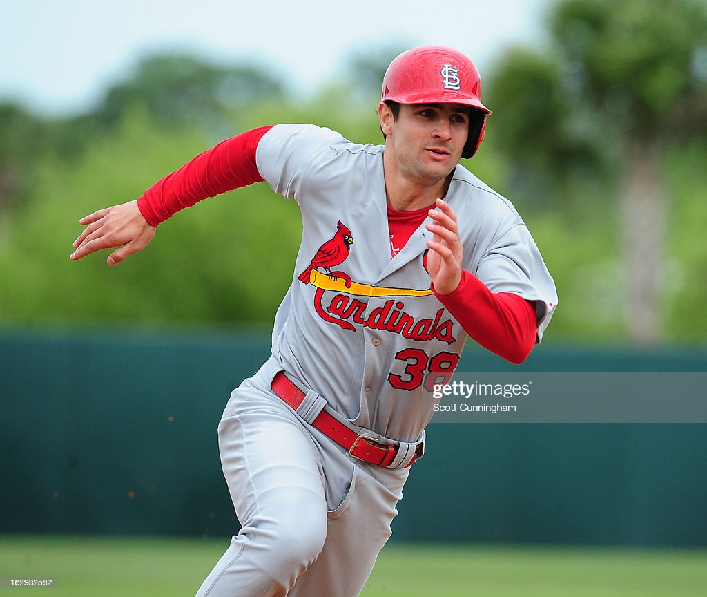 <a gi-track='captionPersonalityLinkClicked' href=/galleries/search?phrase=Pete+Kozma&family=editorial&specificpeople=6800748 ng-click='$event.stopPropagation()'>Pete Kozma</a> #38 of the St. Louis Cardinals rounds third base against the Houston Astros a spring training game at Osceola County Stadium on March 1, 2013 in Kissimmee, Florida.