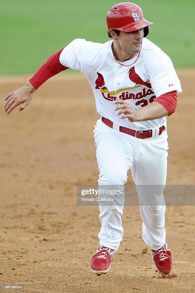 Pete Kozma #38 of the St. Louis Cardinals runs to third base during a spring training game against the New York Mets on March 24, 2013 at Roger Dean Stadium in Jupiter, Florida.