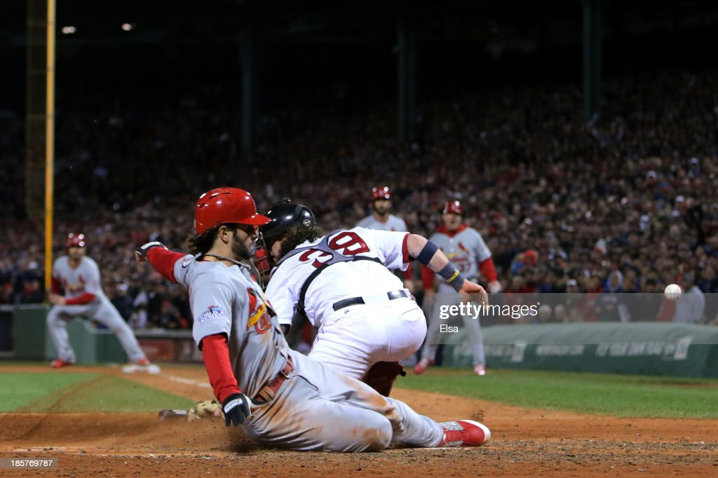 <a gi-track='captionPersonalityLinkClicked' href=/galleries/search?phrase=Pete+Kozma&family=editorial&specificpeople=6800748 ng-click='$event.stopPropagation()'>Pete Kozma</a> #38 of the St. Louis Cardinals scores in the seventh inning against the Boston Red Sox during Game Two of the 2013 World Series at Fenway Park on October 24, 2013 in Boston, Massachusetts.