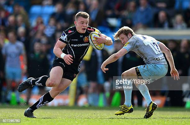 Pete Laverick of Exeter Braves takes on Sam Olver of Northampton Wanderers during the Aviva Premiership A League Final between Exeter Braves and...