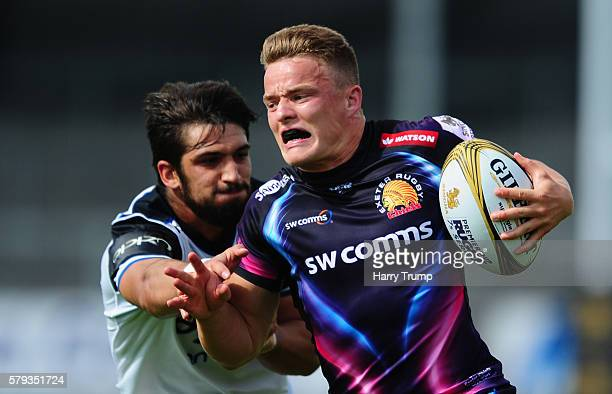 Pete Laverick of Exeter Chiefs is tackled by Josh Baylis of Bath Rugby during the Singha Premiership Rugby 7s Series match between Exeter Chiefs and...