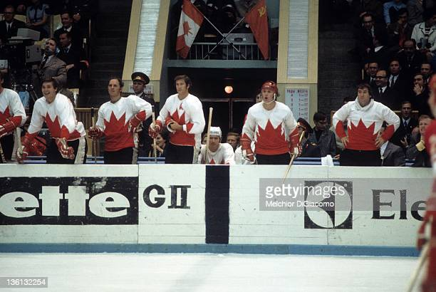 Pete Mahovlich Dennis Hull and Jean Ratelle Red Berenson Paul Henderson and goalie Ed Johnston of Canada look on from the bench during their game...