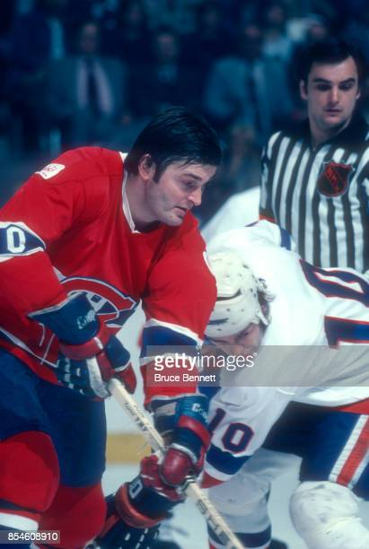 Pete Mahovlich of the Montreal Canadiens battles with Lorne Henning of the New York Islanders during an NHL game circa 1976 at the Nassau Coliseum in...