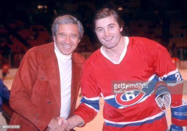 Pete Mahovlich of the Montreal Canadiens poses for a portrait while shaking hands before an NHL game circa 1976