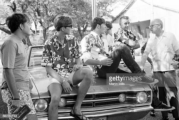 Pete Maravich of Louisiana State Tigers with teammates and his father coach Press Maravich on the set of Hawaii Five0 after the 1969 Rainbow Classic...