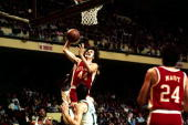 Pete Maravich of the Atlanta Hawks drives to the basket for a layup against the Boston Celtics during the NBA game at the Boston Garden during the...