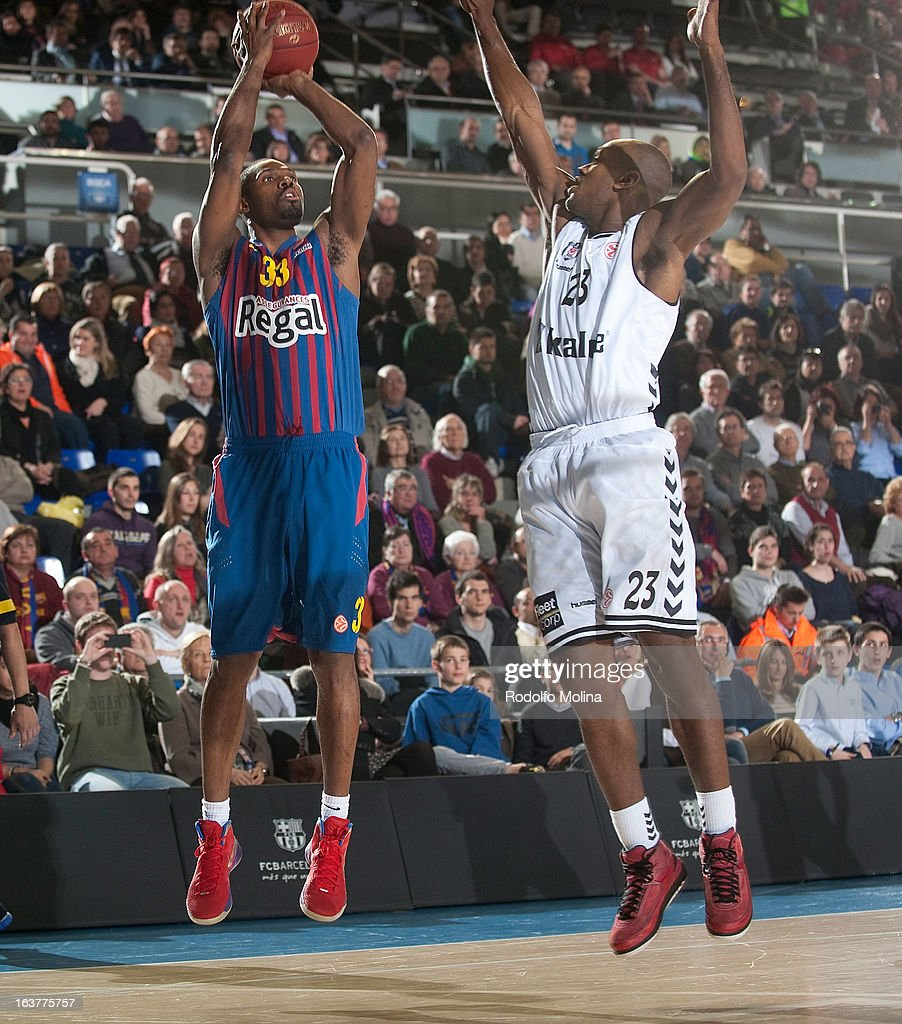 Pete Mickeal, #33 of FC Barcelona Regal competes with Patrick Christopher, #23 of Besiktas JK Istanbul during the 2012-2013 Turkish Airlines Euroleague Top 16 Date 11 between FC Barcelona Regal v Besiktas JK Istanbul at Palau Blaugrana on March 15, 2013 in Barcelona, Spain.
