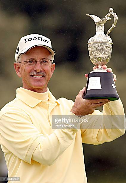 Pete Oakley holds the trophy after winning the 2004 Senior British Open at the Royal Portrush Golf Club