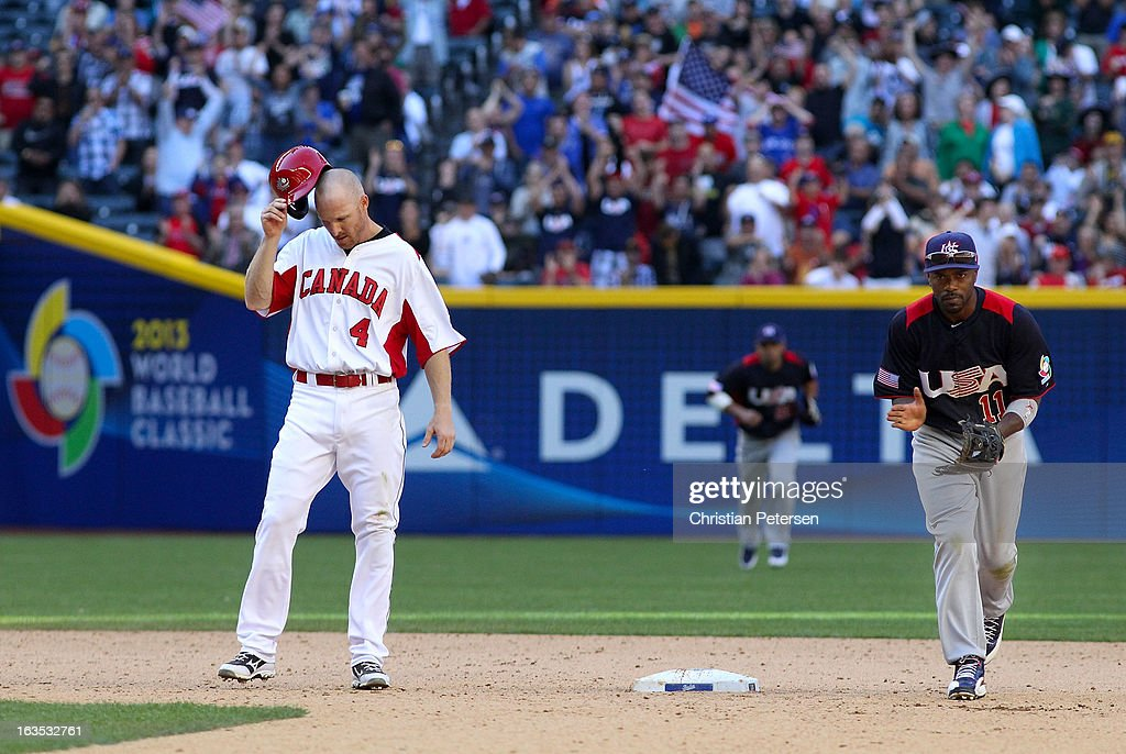 Pete Orr of Canada and infielder Jimmy Rollins of USA react after an inning end during the World Baseball Classic First Round Group D game at Chase...