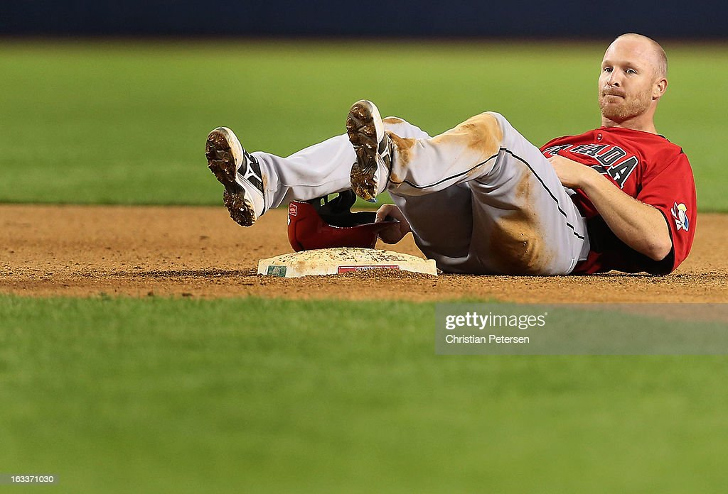 Pete Orr #4 of Canada lays on the field after being forced out at second base during the eighth inning of the World Baseball Classic First Round Group D game against Italy at Chase Field on March 8, 2013 in Phoenix, Arizona.
