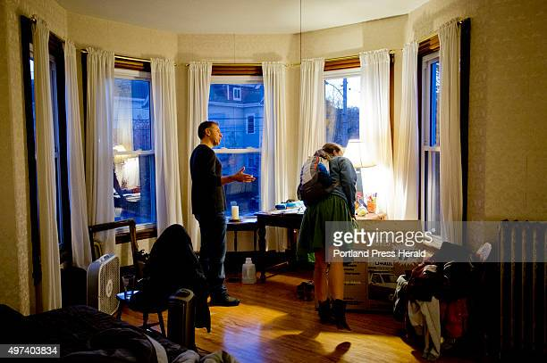 Pete Risano shows Maddie Purcell of Portland a twobedroom apartment for rent in a building that he and his wife Cami own on Munjoy Hill Thursday...