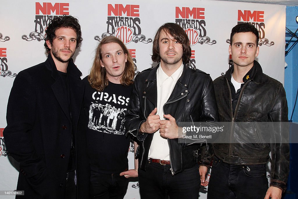 Pete Robertson Freddie Cowan Justin Young and Arni Hjorvar of The Vaccines pose in front of the winners boards at the NME Awards 2012 held at the...