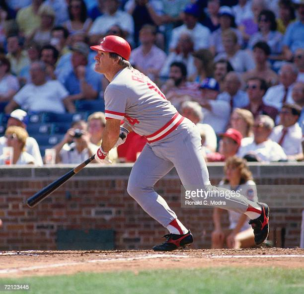 Pete Rose of the Cincinnati Reds hits a home run against the Chicago Cubs in Wrigley Field in September 1985 in Chicago Illlinois
