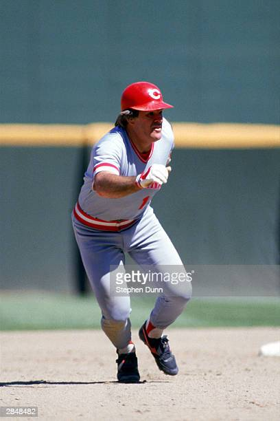 Pete Rose of the Cincinnati Reds runs between bases during a game against the San Diego Padres at Jack Murphy Stadium in the 1986 MLB season in San...