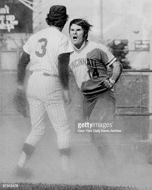 Pete Rose of the Cincinnati Reds starts fight with Bud Harrelson of the New York Mets during a National League playoff game at Shea Stadium