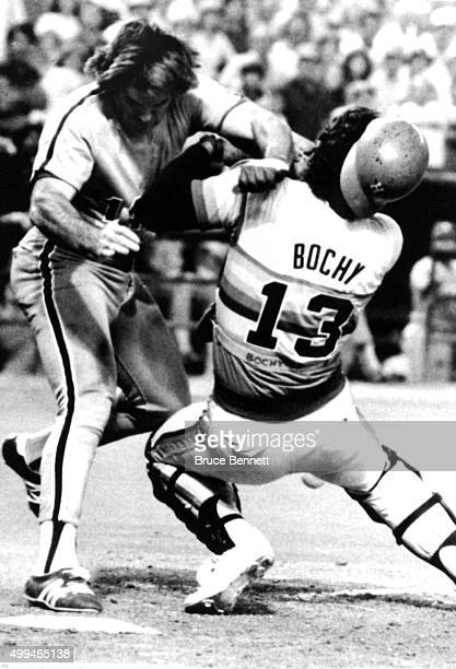 Pete Rose of the Philadelphia Phillies crashes into catcher Bruce Bochy of the Houston Astros to score the winning run in Game 4 of the National...