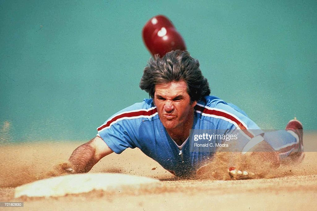 <a gi-track='captionPersonalityLinkClicked' href=/galleries/search?phrase=Pete+Rose&family=editorial&specificpeople=202020 ng-click='$event.stopPropagation()'>Pete Rose</a> #14 of the Philadelphia Phillies slides head-first into third base in March 1986 in Clearwater, Florida.