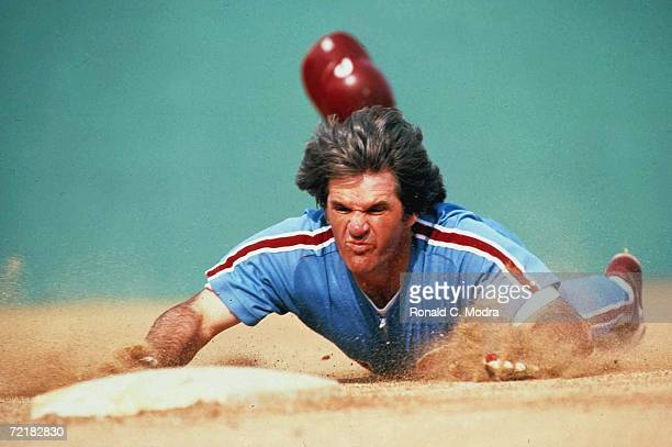 Pete Rose of the Philadelphia Phillies slides headfirst into third base in March 1986 in Clearwater Florida