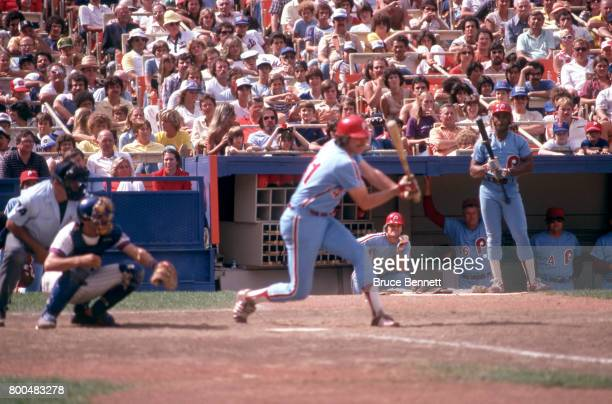 Pete Rose of the Philadelphia Phillies waits in the hole as he and the ondeck batter Lonnie Smith look on as Bob Walk swings at the pitch during an...