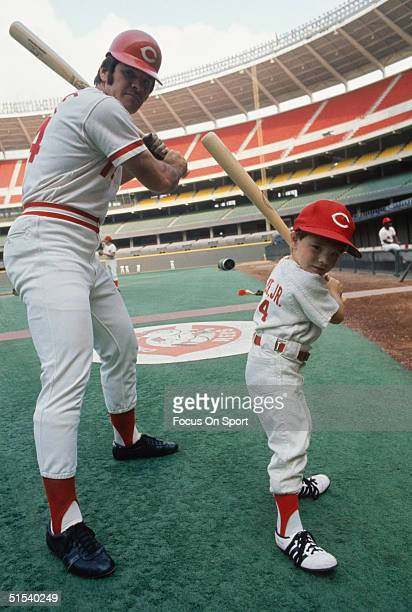 Pete Rose poses with his son Petey at Riverfront Stadium during the 1970s in Cincinnati Ohio
