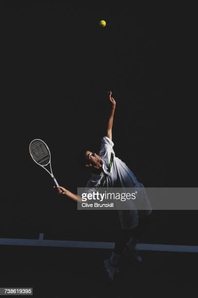 Pete Sampras of the United States serves against Wayne Black during their Men's Singles Third Round match at the Australian Open tennis tournament on...