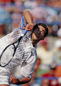 Pete Sampras of the United States serves to Alexander Volkov during their Men's Singles Semi Final match of the United States Open Tennis...