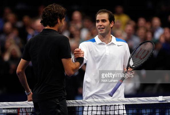 Pete Sampras shakes hands with Roger Federer of Switzerland after Federer won in a third set tie break during their exhibition match on March 10 2008...