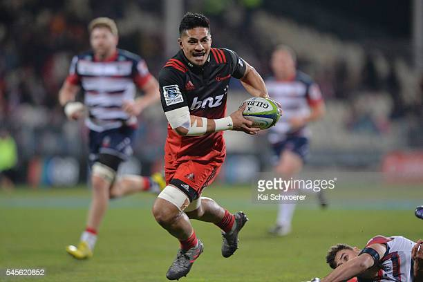 Pete Samu of the Crusaders runs through to score a try during the round 16 Super Rugby match between the Crusaders and the Rebels at AMI Stadium on...