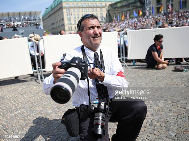 Pete Souza American photojournalist and Chief Official White House photographer waits for the US President to give a speech in front of Berlin's...
