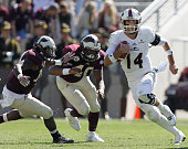 Pete Thomas of the Louisiana Monroe Warhawks rushes past Jarrett Johnson of the Texas AM Aggies at Kyle Field on November 1 2014 in College Station...