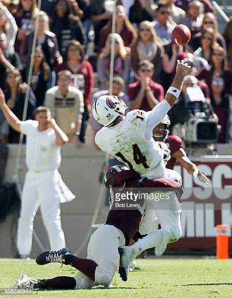 Pete Thomas of the Louisiana Monroe Warhawks takes hard hit from Daeshon Hall of the Texas AM Aggies as releases the ball at Kyle Field on November 1...
