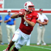 Pete Thomas of the North Carolina State Wolfpack drops back to pass against the Louisiana Tech Bulldogs at CarterFinley Stadium on August 31 2013 in...