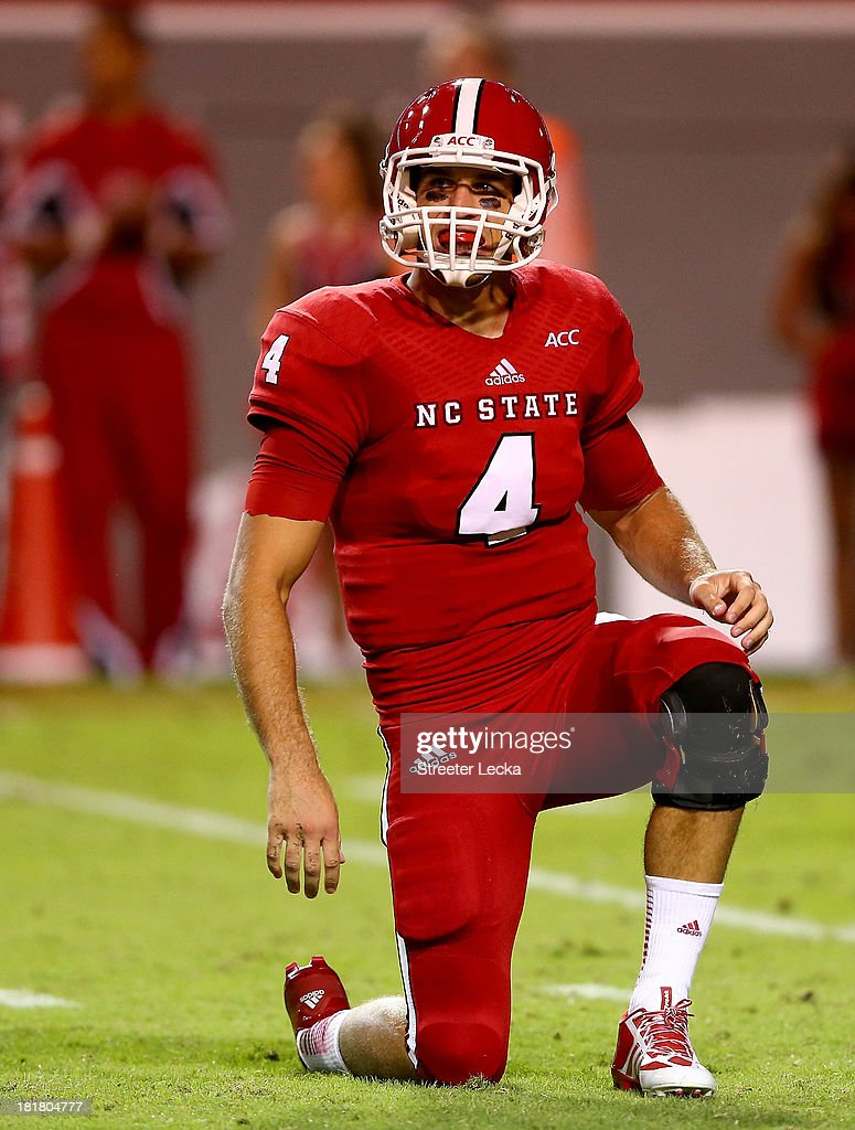 Pete Thomas #4 of the North Carolina State Wolfpack during their game at Carter-Finley Stadium on September 19, 2013 in Raleigh, North Carolina.