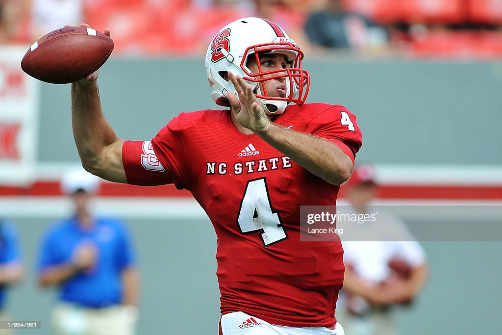 Pete Thomas #4 of the North Carolina State Wolfpack passes against the Louisiana Tech Bulldogs at Carter-Finley Stadium on August 31, 2013 in Raleigh, North Carolina.