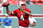 Pete Thomas of the North Carolina State Wolfpack passes against the Louisiana Tech Bulldogs at CarterFinley Stadium on August 31 2013 in Raleigh...