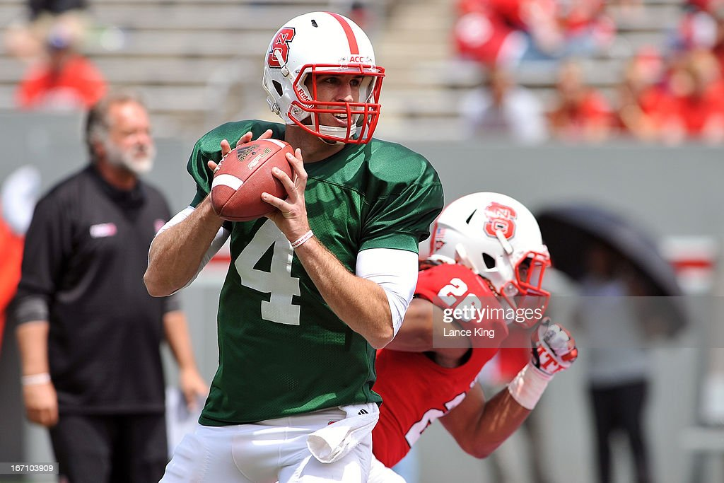 <a gi-track='captionPersonalityLinkClicked' href=/galleries/search?phrase=Pete+Thomas&family=editorial&specificpeople=4598308 ng-click='$event.stopPropagation()'>Pete Thomas</a> #4 of the North Carolina State Wolfpack warms up during the Kay Yow Spring Football Game at Carter-Finley Stadium on April 20, 2013 in Raleigh, North Carolina.
