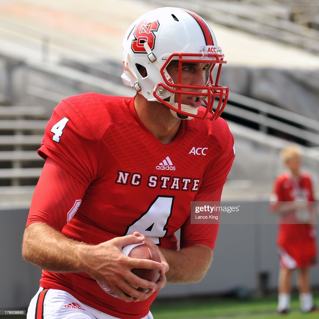 Pete Thomas #4 of the North Carolina State Wolfpack warms up prior to a game against the Louisiana Tech Bulldogs at Carter-Finley Stadium on August 31, 2013 in Raleigh, North Carolina. The Wolfpack defeated the Bulldogs 40-14.