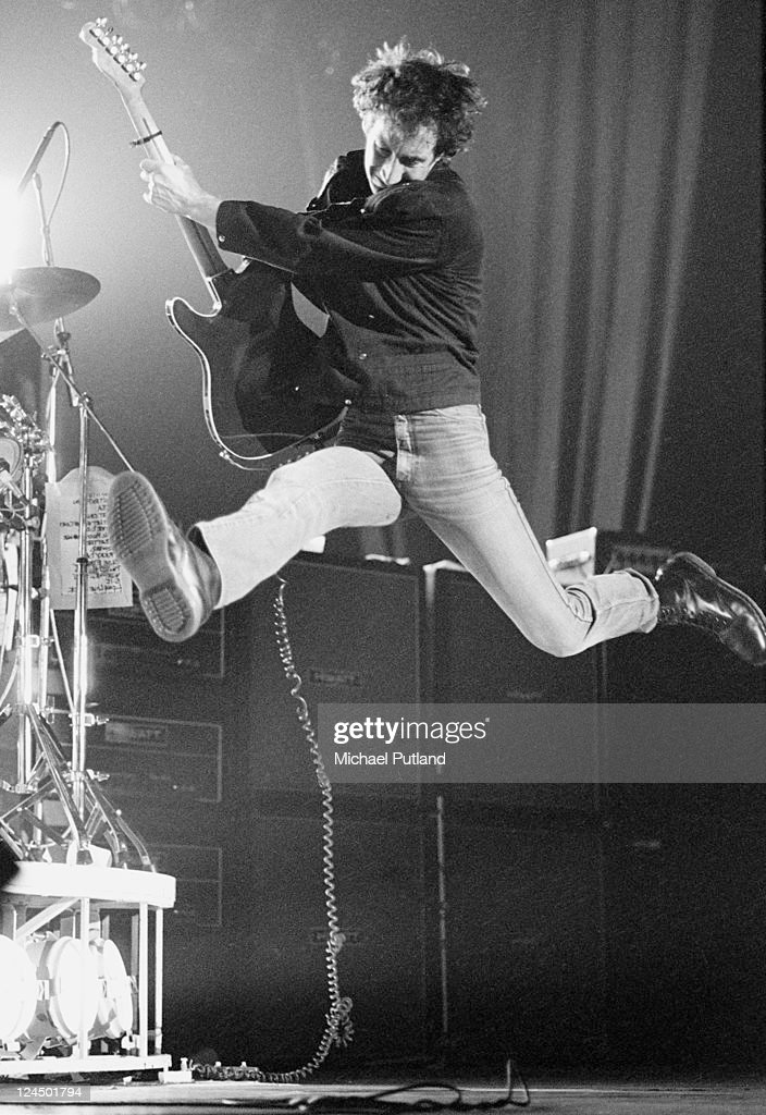 Pete Townshend of The Who leaps in the air while performing live on stage, London, February 1981.