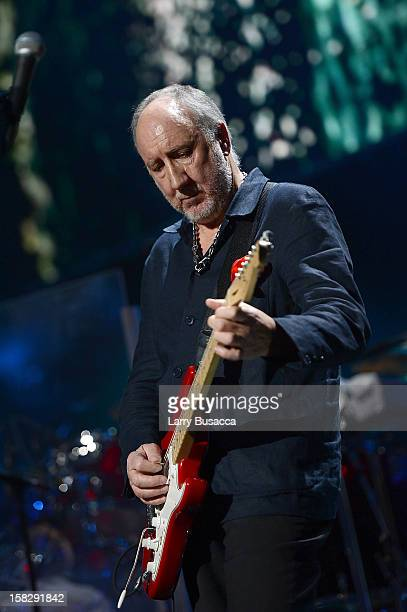 Pete Townshend of The Who performs at '121212' a concert benefiting The Robin Hood Relief Fund to aid the victims of Hurricane Sandy presented by...