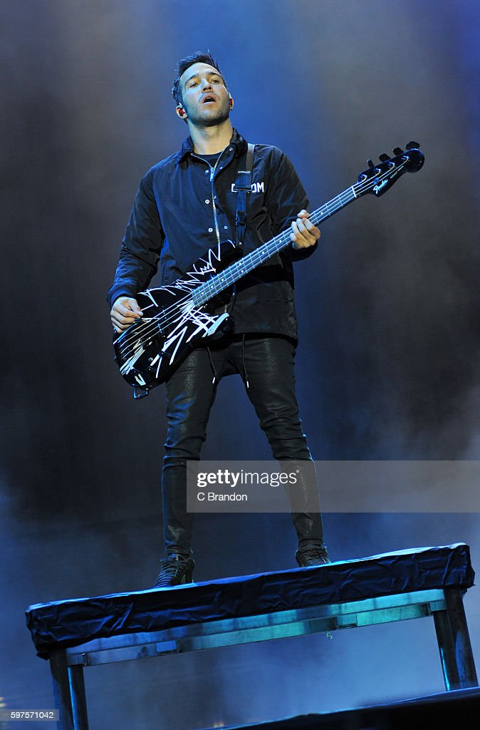 Pete Wentz of Fall Out Boy performs on stage during Day 3 of the Reading Festival at Richfield Avenue on August 28 2016 in Reading England