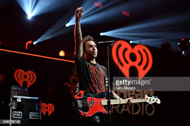 Pete Wentz of Fall Out Boy performs onstage during Y100's Jingle Ball 2013 Presented by Jam Audio Collection at BBT Center on December 20 2013 in...