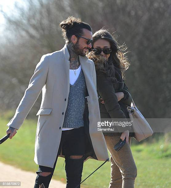 Pete Wicks and Megan Mckenna are pictured walking his dogs as they film scenes for TOWIE