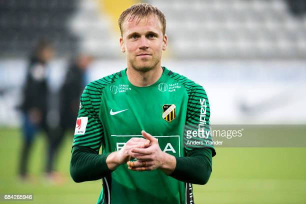 Peter Abrahamsson goalkeeper of BK Hacken cheers to the fans after the Allsvenskan match between BK Hacken and Halmstad BK at Bravida Arena on May 17...