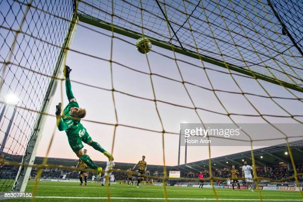 Peter Abrahamsson goalkeeper of BK Hacken throws himself and fails to stop Daniel Sundgren of AIK who scores 15 during the Allsvenskan match between...