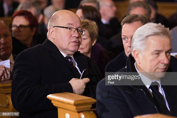 Peter Altmaier and Klaus Wowereit attend the state funeral of the late former German President Roman Herzog at the Dom Cathedral on January 24 2017...