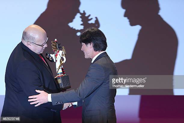 Peter Altmeier gives the Media Award to Joachim Loew during the German Media Award 2014 on January 23 2015 in BadenBaden Germany